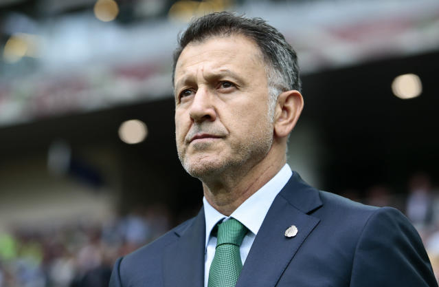 FILE - In this July 2, 2017, file photo, Mexico coach Juan Carlos Osorio waits for the kick-off of the Confederations Cup, third place soccer match between Portugal and Mexico, in Moscow, Russia. Mexico coach Juan Carlos Osorio has been effectively banned from the Gold Cup by FIFA for insulting match officials. FIFA banned Osorio for six matches on Friday, July 7, 2017, for his behavior during the Confederations Cup third-place game last Sunday, when Mexico lost to Portugal 2-1. (AP Photo/Denis Tyrin, File)