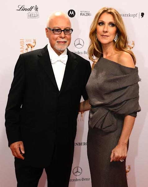 Canadian singer Celine Dion (R) and her husband Rene Angelil pose for photographers as they arrive on the red carpet for the Bambi awards in Duesseldorf, western Germany, on November 22, 2012 (AFP Photo/John MacDougall)