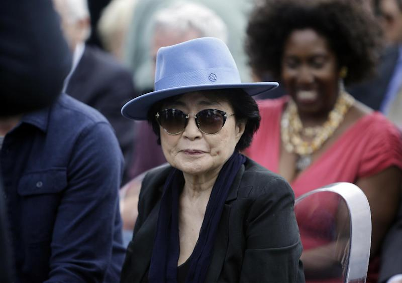 Yoko Ono appears before the dedication ceremony for her permanent art installation, a sculpture called SKYLANDING, at Jackson Park, Monday, Oct. 17, 2016, in Chicago. It is Ono's first permanent public art installation in the United States. (AP Photo/Kiichiro Sato)
