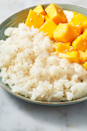 """<p>Cooking in coconut milk will give you the most flavourful rice, without any effort. This is a great dessert to be able to make ahead as it's good either cold or at room temperature.</p><p>Get the <a href=""""https://www.delish.com/uk/cooking/recipes/a35476822/mango-sticky-rice-recipe/"""" rel=""""nofollow noopener"""" target=""""_blank"""" data-ylk=""""slk:Mango Sticky Rice"""" class=""""link rapid-noclick-resp"""">Mango Sticky Rice</a> recipe.</p>"""