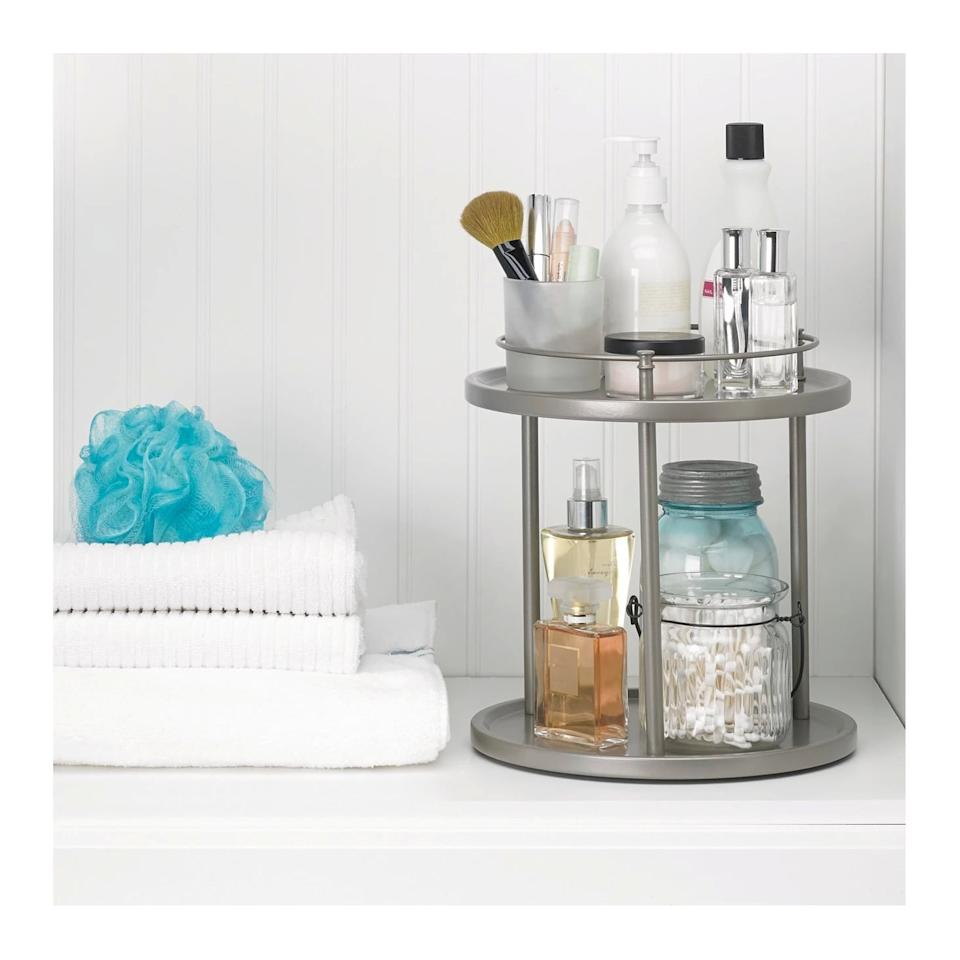 "<p>Place the <a href=""https://www.popsugar.com/buy/Under-Vanity-Double-Level-Spinning-Storage-Rack-Champagne-480174?p_name=Under%20Vanity%20Double%20Level%20Spinning%20Storage%20Rack%20in%20Champagne&retailer=target.com&pid=480174&price=15&evar1=casa%3Aus&evar9=46500928&evar98=https%3A%2F%2Fwww.popsugar.com%2Fphoto-gallery%2F46500928%2Fimage%2F46500944%2FUnder-Vanity-Double-Level-Spinning-Storage-Rack-Champagne&list1=target%2Corganization%2Cbathrooms&prop13=api&pdata=1"" rel=""nofollow"" data-shoppable-link=""1"" target=""_blank"" class=""ga-track"" data-ga-category=""Related"" data-ga-label=""https://www.target.com/p/under-vanity-double-level-spinning-storage-rack-champagne-88-main/-/A-50281479"" data-ga-action=""In-Line Links"">Under Vanity Double Level Spinning Storage Rack in Champagne</a> ($15) under your sink or in a cabinet to easily access all of your vanity items.</p>"