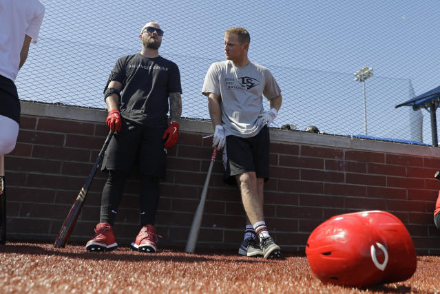 Cincinnati Reds' Tucker Barnhart, left, talks with Josh VanMeter during a workout at Grand Park, Friday, June 12, 2020, in Westfield, Ind. Proceeds from the event will go to Reviving Baseball in the Inner City of Indianapolis. (AP Photo/Darron Cummings)