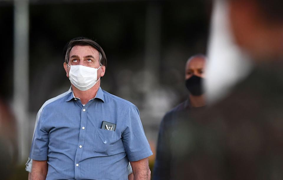 TOPSHOT - Brazilian President Jair Bolsonaro attends the flag unveiling ceremony in the garden of the Alvorada Palace in Brasilia, on July 24, 2020. (Photo by EVARISTO SA / AFP) (Photo by EVARISTO SA/AFP via Getty Images)