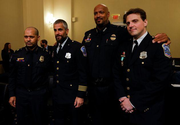 U.S. Capitol Police Sgt. Aquilino Gonell, Metropolitan Police Department Officer Michael Fanone, U.S. Capitol Police Officer Harry Dunn and Metropolitan Police Officer Daniel Hodges stand together on July 27 following the opening hearing of the House select committee investigating the Jan. 6 attack on the U.S. Capitol. (Photo: Jim Bourg via Reuters)