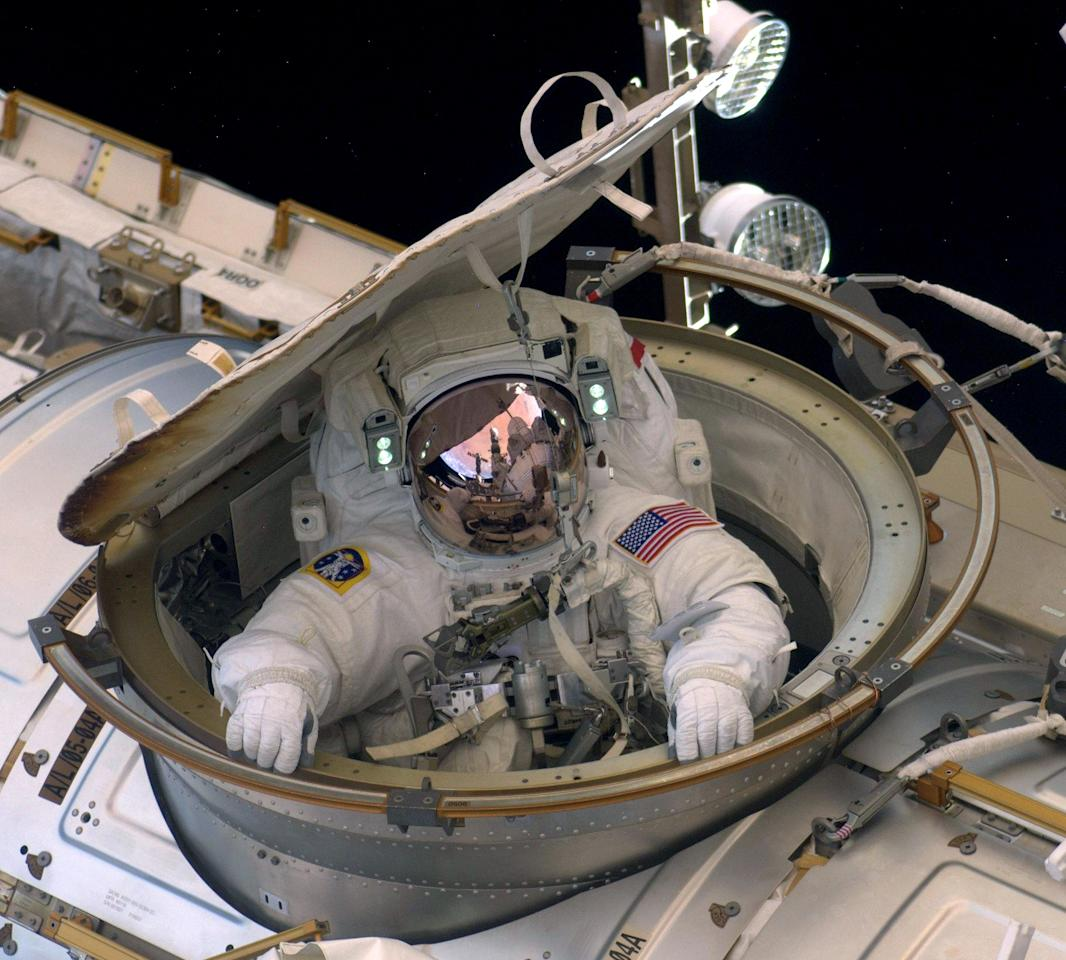 IN SPACE - MAY 22: In this handout provided by National Aeronautics and Space Administration (NASA), Astronaut Andrew Feustel reenters the space station after completing n 8-hour, 7-minute spacewalk at 10:12 a.m. EDT as NASA space shuttle Endeavour makes its last visit to the International Space Station on May 22, 2011 in space. After 20 years, 25 missions and more than 115 million miles in space, Endeavour is on its final flight to the International Space Station before being retired and donated to the California Science Center in Los Angeles. Capt. Mark E. Kelly, U.S. Rep. Gabrielle Giffords' (D-AZ) husband, will lead mission STS-134 as it delivers the Express Logistics Carrier-3 (ELC-3) and the Alpha Magnetic Spectrometer (AMS-2) to the International Space Station. (Photo by NASA via Getty Images)