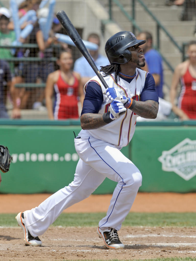 New York Mets' Jose Reyes doubles in the sixth inning of the Brooklyn Cyclones baseball game against the Lowell Spinners in the New York City borough of Brooklyn, Monday, July 18, 2011. Reyes made a rehabilitation start for Class-A Brooklyn.  (AP Photo/Henny Ray Abrams)