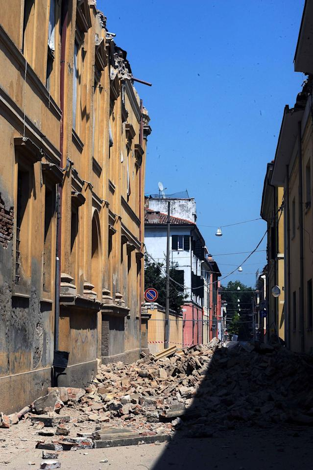 MIRANDOLA, ITALY - MAY 29:   Evacuated buildings in the center of Mirandola damaged by an earthquake on May 29, 2012 in Mirandola, Italy.  The Emilia-Romagna region was again stricken by a series of strong earthquakes, some reaching 5.8 on the richter scale, with the death toll rising to at least 16 people.  (Photo by Roberto Serra/Iguana Press/Getty Images)
