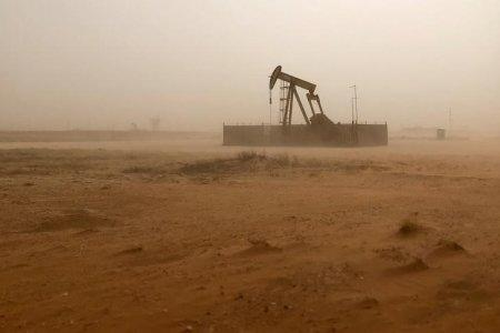 FILE PHOTO: A pump jack lifts oil out of a well, during a sandstorm in Midland, Texas, U.S., April 13, 2018. REUTERS/Ann Saphir/File Photo
