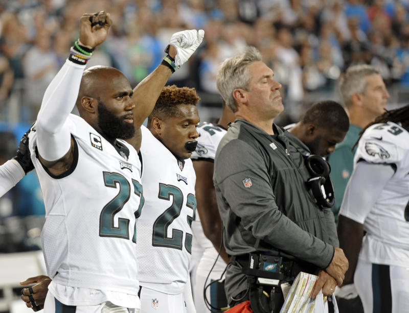 Eagles players raise a fist during the national anthem last season. Players were demonstrating to bring attention to social issues. (AP)