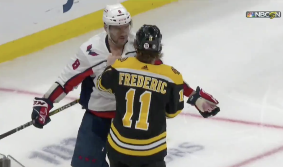 Alex Ovechkin and Trent Frederic had quite a battle going during Wednesday's Bruins-Capitals clash. (Getty)