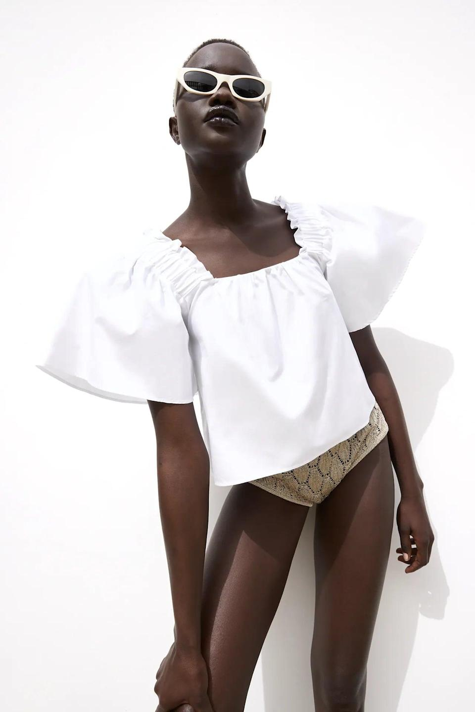<p>This <span>Full Sleeve Poplin Top</span> ($40) adds drama and style to any look.</p>