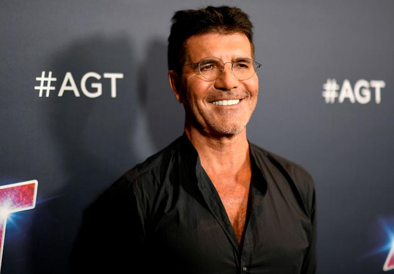 Simon Cowell has admitted he is concerned about coronavirus and him and his son will wear masks on their upcoming trip (Getty)