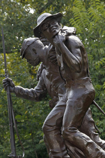 This nine-foot tall sculpture photographed at the Vicksburg National Military Park in Vicksburg, Miss., Thursday, Aug. 16, 2012, honors black soldiers and civilians that fought for their freedom and in support of the Union. The statue depicts three figures - two Union soldiers representing the 1st and 3d Mississippi Infantry, African Descent,  and participated in the Vicksburg campaign, and the third figure is a civilian laborer. (AP Photo/Rogelio V. Solis)