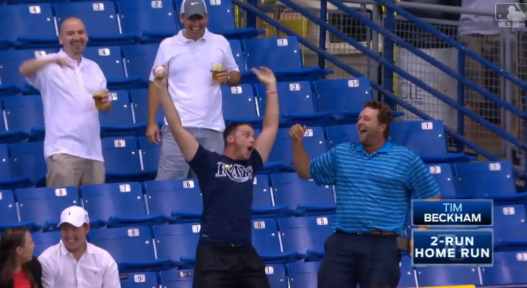 A fan waves his arms after catching Tim Beckham's second inning home run. (MLB.TV)