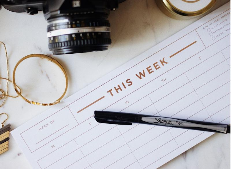 Weekly planner with pen and camera