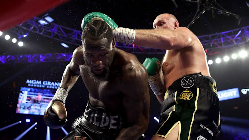 Wilder injured arm in boxing loss to Fury