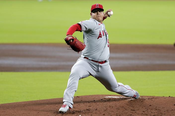 """Angels pitcher Jose Suarez throws against the Houston Astros during the first inning of the first game of a doubleheader Tuesday in Houston. <span class=""""copyright"""">(Michael Wyke / Associated Press)</span>"""