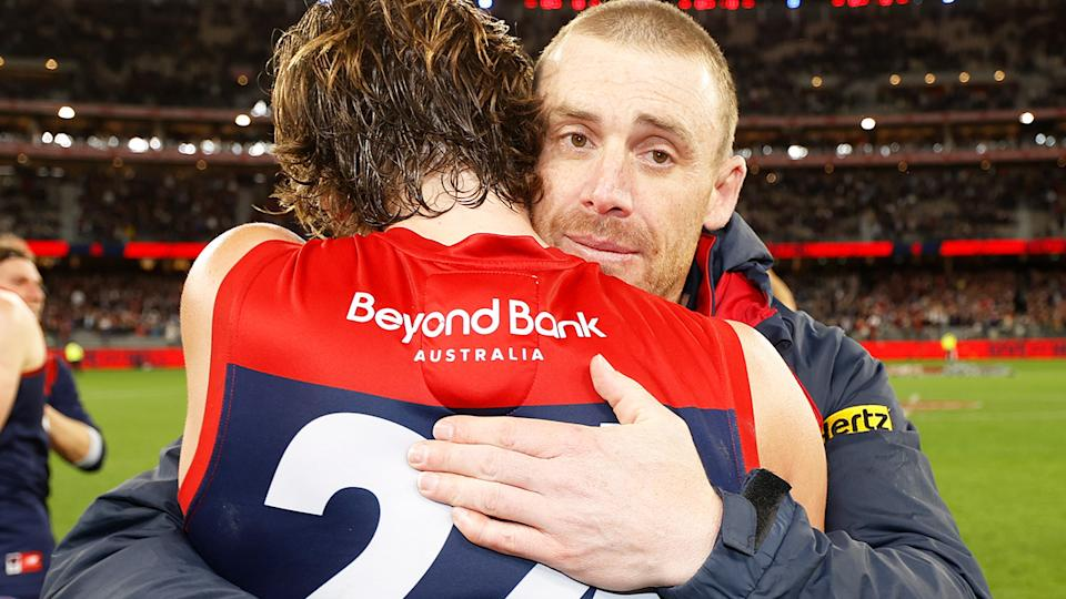 Simon Goodwin, pictured here hugging Trent Rivers after the Melbourne Demons' victory over Geelong.