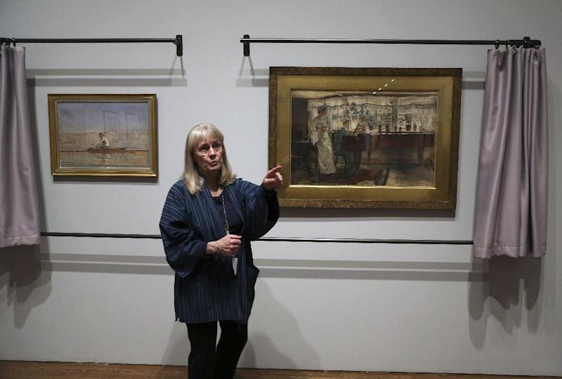 "In this Tuesday Feb. 21, 2017 photo, Kathleen A Foster, Senior Curator of American Art at the Philadelphia Museum of Art speaks in front of two watercolor paintings in Philadelphia. ""American Watercolor in the Age of Homer and Sargent"" will be on view from March 1 to May 14, 2017, bringing together masterpieces drawn from public and private collections throughout the county, and will be shown only in Philadelphia. (AP Photo/Jacqueline Larma)"