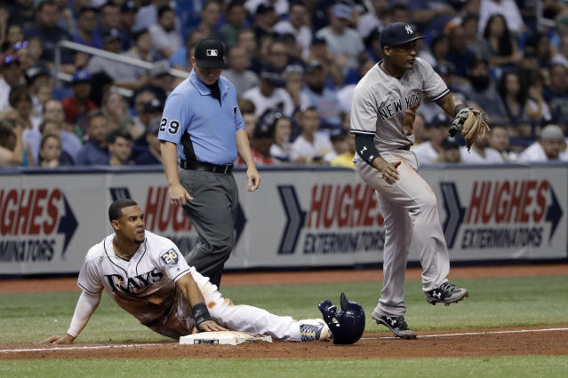 Tampa Bay Rays' Carlos Gomez, left, slides safely into third as New York Yankees' Miguel Andujar fields a throw on a single by Willy Adames during the sixth inning of a baseball game Friday, June 22, 2018, in St. Petersburg, Fla. (AP Photo/Chris O'Meara)