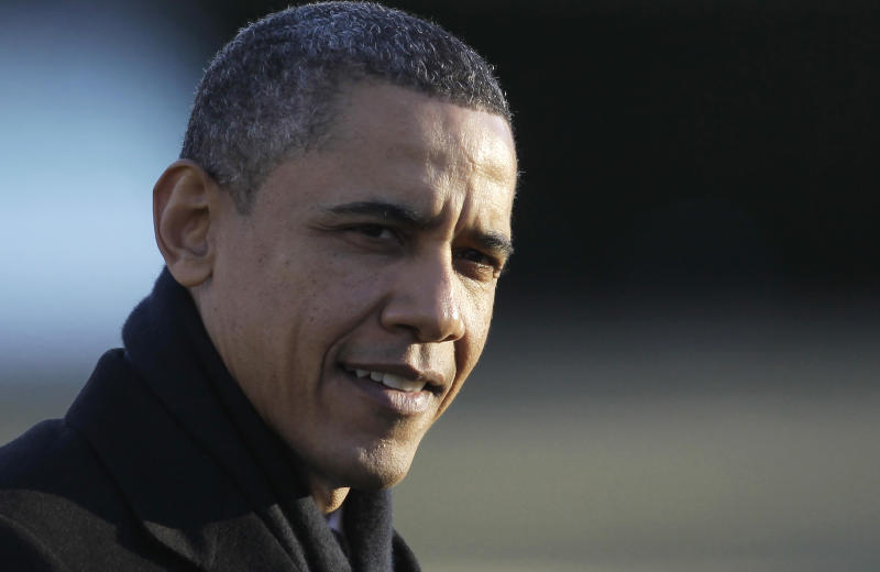 President Barack Obama returns to the White House in Washington, Thursday, Feb. 10, 2011, after traveling to Marquette, Mich.. (AP Photo/Charles Dharapak)