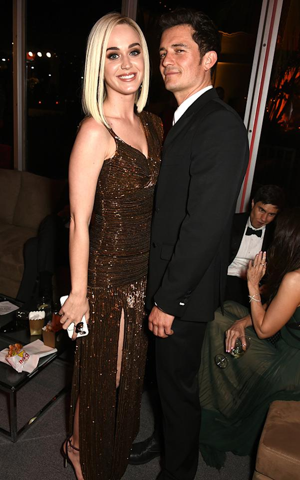 <p>One year after they began their romance, the pretty pair partied together — after solo turns on the red carpet — at the Vanity Fair bash. While their couple pose game needs a little work (Lando, the camera is in this direction), they seemed to be having a good time — as evident by those smiles. (Photo: Dave M. Benett/VF17/WireImage) </p>