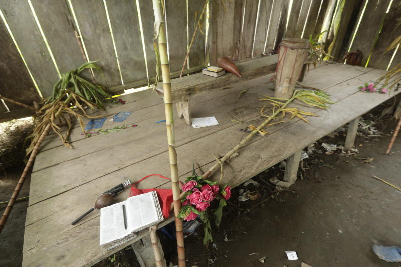 Bibles, flowers, a drum and a microphone are seen inside the improvised temple where a pregnant woman, five of her children and a neighbour were killed in a religious ritual in a jungle community in El Terron, Panama, Friday, Jan. 17, 2020.