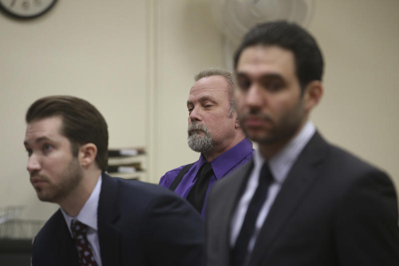 Dean Smith, center, a defendant in the Holland Tunnel weapons case, appears before Hudson County Superior Court Judge Mitzy Galis-Menendez in Jersey City, N.J., where he faces weapons possession charges. (Ed Murray/NJ Advance Media via AP, Pool)
