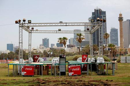 FILE PHOTO: The minaret of the Hassan Bek Mosque is seen in the background during the construction of the Eurovision Village, a space dedicated for fans of the 2019 Eurovision Song Contest, in Tel Aviv, Israel May 6, 2019. REUTERS/Corinna Kern/File Photo