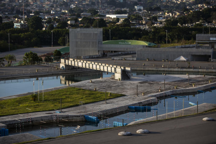 The sun sets over the Olympic canoe slalom circuit at Radical Park in Rio de Janeiro, Brazil, Thursday, June 24, 2021. The park's centerpiece, a reservoir feeding a rapids course, is used by the Brazilian canoeing confederation to train. (AP Photo/Bruna Prado)