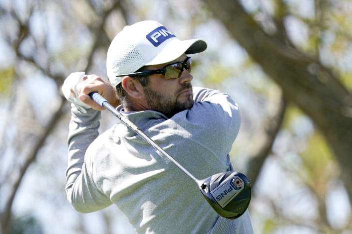 Corey Conners hits a shot from the third tee during the final round of the Arnold Palmer Invitational golf tournament Sunday, March 7, 2021, in Orlando, Fla. (AP Photo/John Raoux)