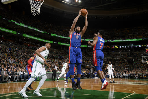 Andre Drummond pulls down a rebound against the Celtics on Monday night. (Getty Images)