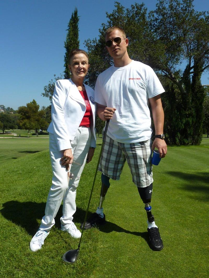 Maggie Lockridge poses with veteran Neil Duncan, who was wounded overseas.