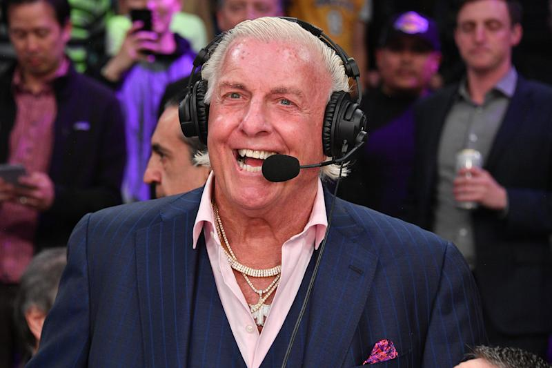 LOS ANGELES, CALIFORNIA - FEBRUARY 25: Ric Flair joins a telecast during a basketball game between the Los Angeles Lakers and the New Orleans Pelicans at Staples Center on February 25, 2020 in Los Angeles, California. (Photo by Allen Berezovsky/Getty Images)