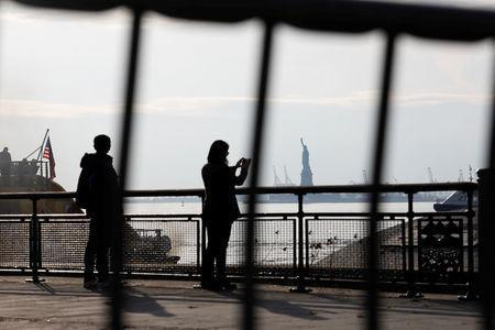 The Statue of Liberty is seen through fencing from a ferry dock following a U.S. government shutdown in Manhattan, New York, U.S., in New York, U.S. January 21, 2018. REUTERS/Shannon Stapleton