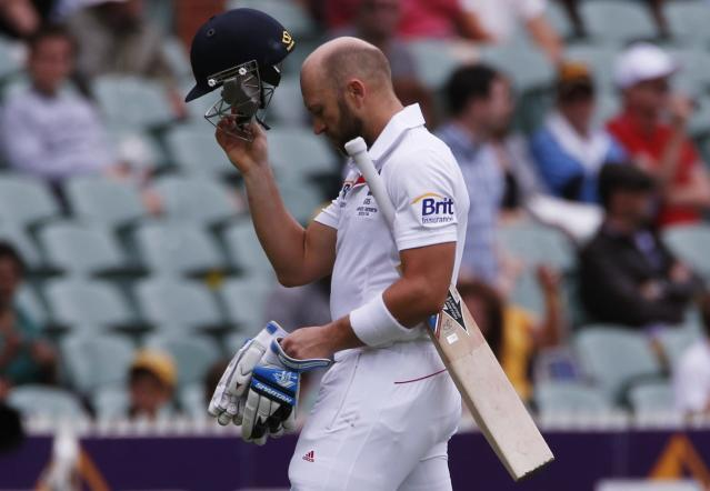 England's Matt Prior walks off the field after his dismissal during the fifth day's play in the second Ashes cricket test against Australia at the Adelaide Oval December 9, 2013. REUTERS/David Gray (AUSTRALIA - Tags: SPORT CRICKET)