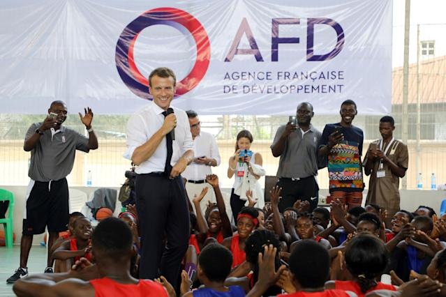 French President Emmanuel Macron delivers his speech during a meeting with former pro basketball players from NBA Africa and a practice session with young basketball players at the French Louis Pasteur high school in Lagos, Nigeria, July 4, 2018. Ludovic Marin/Pool via Reuters