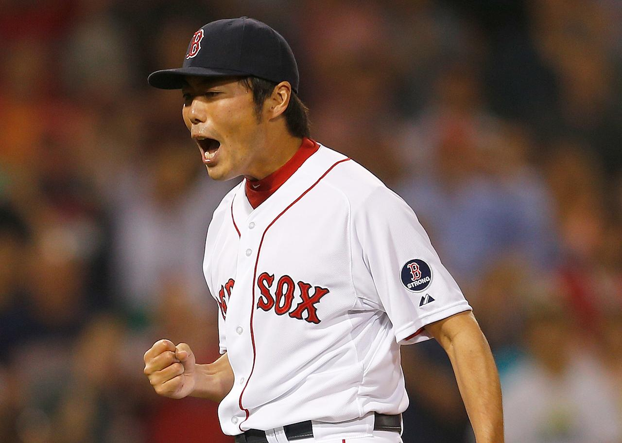 BOSTON, MA - July 2: Koji Uehara #19 of the Boston Red Sox reacts after he earned a save in a 4-1 win against the San Diego Padres in the 9th inning at Fenway Park on July 2, 2013 in Boston, Massachusetts. (Photo by Jim Rogash/Getty Images)