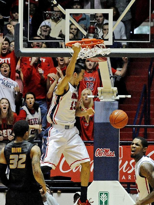 Mississippi forward Anthony Perez (13) dunks the ball as Missouri guard Jabari Brown (32) stands near during the first half of an NCAA college basketball game in Oxford, Miss., Saturday, Feb. 8, 2014. (AP Photo/Thomas Graning)