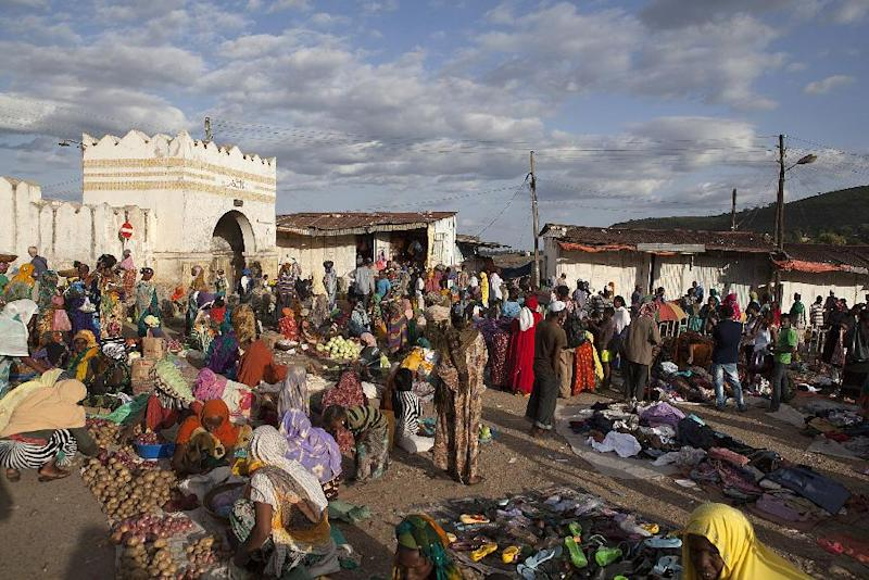 People shop at a market set up in front of the Shoa Gate in Ethiopia on August 3, 2014