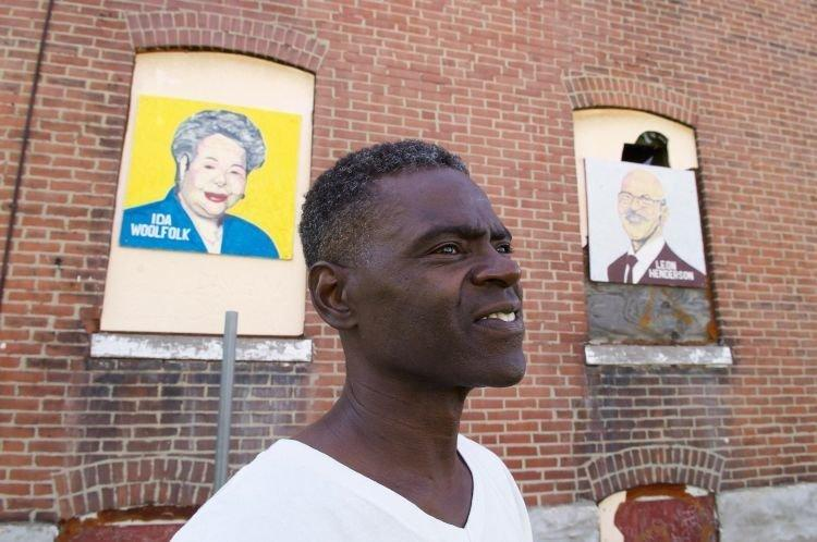 Green poses with some of his paintings.<i></i> (Wiley Price / St Louis American)