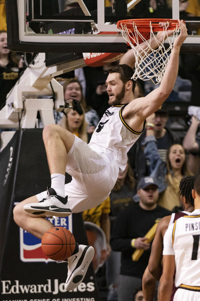 Missouri's Reed Nikko dunks the ball during the first half of an NCAA college basketball game against Mississippi State Saturday, Feb. 29, 2020, in Columbia, Mo. (AP Photo/L.G. Patterson)