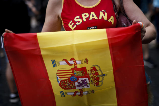 <p>A protestor holds a Spanish flag during a demonstration called by far-right groups against a referendum on independence for Catalonia, on Oct. 1, 2017 in Barcelona. (Photo: Fabio Bucciarelli/AFP/Getty Images) </p>