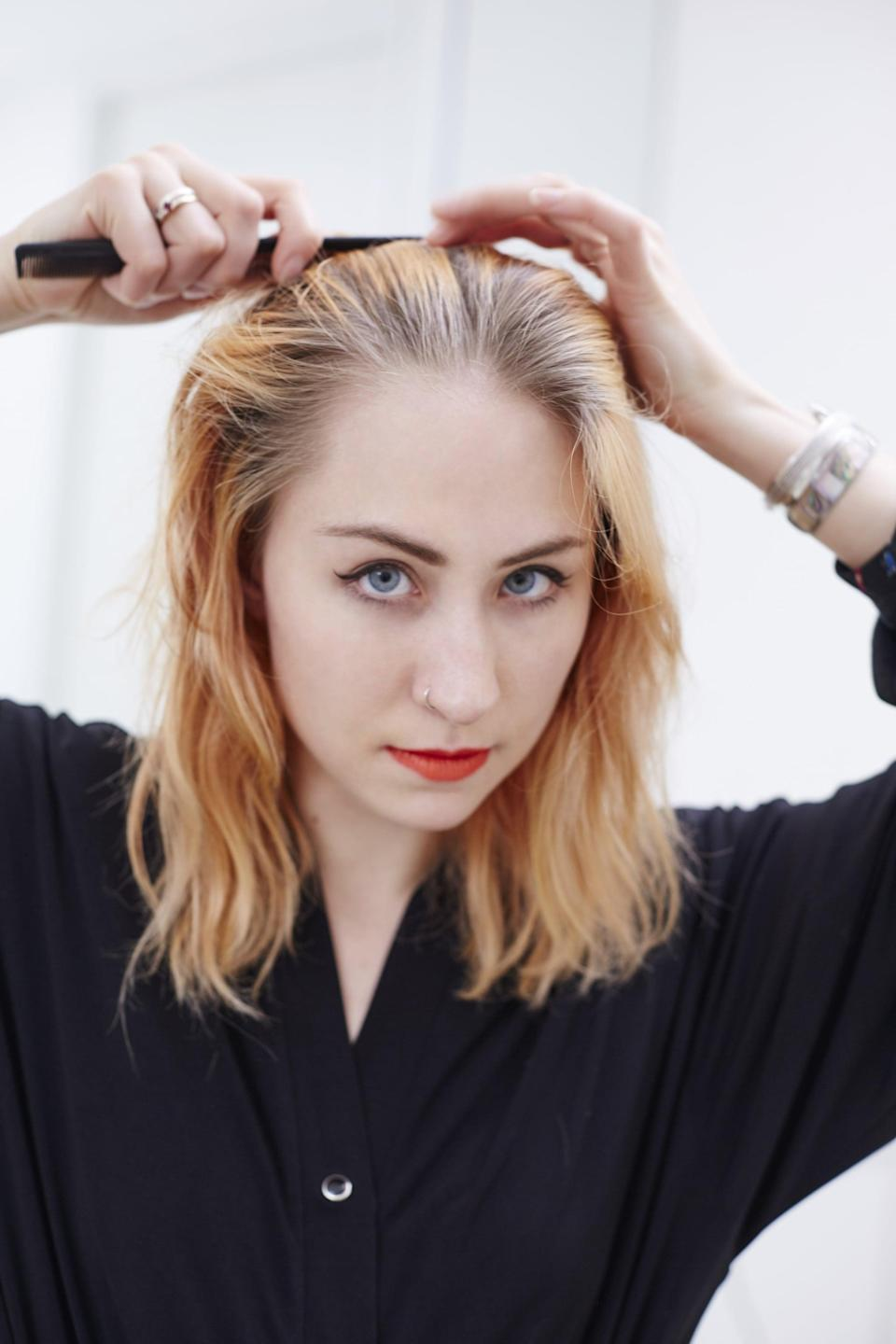 <p>Part your hair however you usually do - middle or side - and begin to section it off. The sections should be about an inch to an inch-and-a-half big.</p>