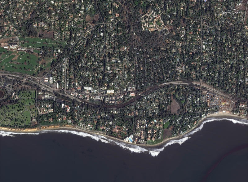 This Jan. 10, 2018 satellite image released by DigitalGlobe News Bureau shows Highway 101 after storms caused mudslides and flooding in Montecito, Calif. The number of missing after a California mudslide has fluctuated wildly, due to shifting definitions, the inherent uncertainty that follows a natural disaster, and just plain human error. (DigitalGlobe News Bureau via AP)