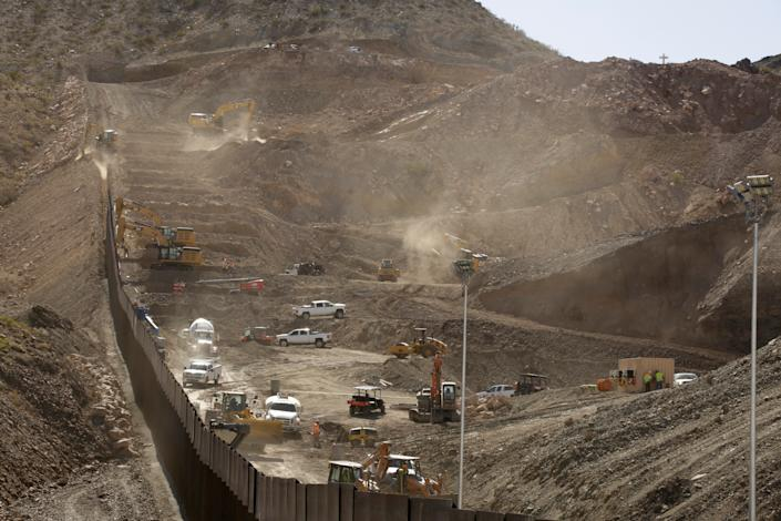 A construction crew works on the private border wall on May 30, as pictured from Ciudad Juarez, Mexico. (Photo: Jose Luis Gonzalez/Reuters)