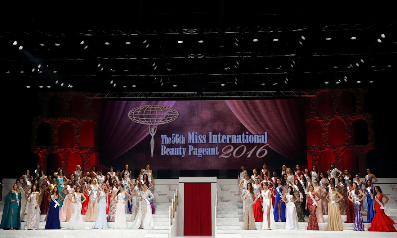 Contestants wearing evening dresses pose during the 56th Miss International Beauty Pageant in Tokyo, Japan October 27, 2016. REUTERS/Kim Kyung-Hoon