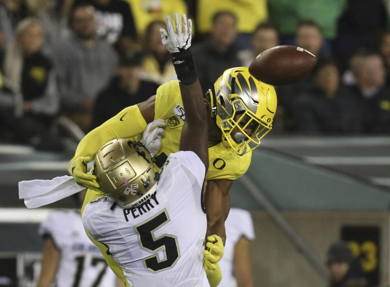 Colorado safety Mark Perry (5) defends on an incomplete pass to Oregon wide receiver Johnny Johnson III during the second quarter of an NCAA college football game Friday, Oct. 11, 2019, in Eugene, Ore. (AP Photo/Chris Pietsch)