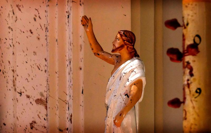 Blood stains are seen on the wall and on a Jesus Christ statue at the St. Sebastian's Church after blast in Negombo, north of Colombo, Sri Lanka, April 21, 2019. More than two hundred people were killed and hundreds more injured in eight blasts that rocked churches and hotels in and just outside Sri Lanka's capital on Easter Sunday. (Photo: AP)