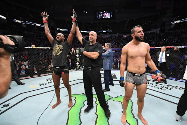(L-R) Jon Jones celebrates his victory over Dominick Reyes in their light heavyweight championship bout during UFC 247 at Toyota Center on Feb. 8, 2020 in Houston, Texas. (Josh Hedges/Zuffa LLC via Getty Images)